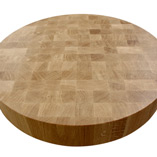 A circular oak end grain butchers block with Rustins Danish oil applied.