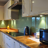 This kitchen's owner chose to arrange zebrano worktops with the detailed end grain on show.