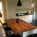 Our solid walnut worktops are the perfect choice for kitchen islands and breakfast bars in a modern kitchen.