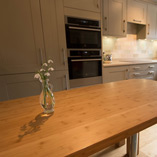 This caramel bamboo worktop features four smooth radius corners was created into a large dining table.