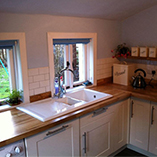 Beech worktops with an overmounted sink.