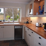 Beech worktops with overmounted sink.