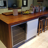 Full Stave iroko used to grand effect in this kitchen.