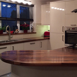 American walnut, cut with a large irregular ellipse end and a variety of custom cuts.