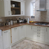 Solid walnut worktops are perfect alongside Shaker oak in-frame cabinets.