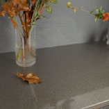 Combining glitter worktops with stone effect splashbacks creates a dramatic aesthetic.