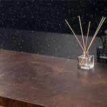 For a dramatic look, pair our copper effect laminate surfaces with dark walls and cabinets