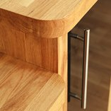 Solid oak worktops over two levels joined by an additional vertical section of oak.