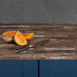 The dark colours of this driftwood effect worktop perfectly complement the dark blue of these cabinet doors.