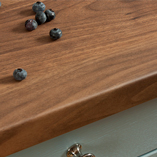 Dark walnut Wilsonart worktops have a smooth front edge profile that makes them suitable for even the busiest kitchens.