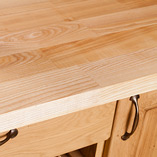 Deluxe Ash solid wood worktops such as this are ideal for kitchens with a traditional or country theme.