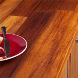 Iroko worktops are suited to both modern and traditional kitchens, but work particularly well alongside lacquered oak kitchen units with traditional frontals.