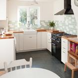 Deluxe Oak worktops combine perfectly with features such as Belfast sinks to create a stunning classic kitchen look.