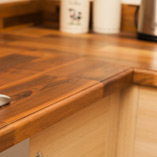 This Deluxe Walnut worktop features a rounded top profile with step that softens the edge of the worktop whilst adding additional character.