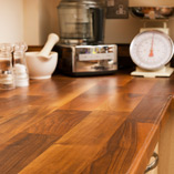 Consider combining our Deluxe Walnut worktops with solid oak cabinets and doors to create a hard-wearing wooden kitchen.