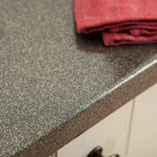 These grey glitter worktops have been constructed from durable wooden particle board and a hardwearing decorative laminate top layer.