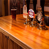 Our full stave iroko worktops were chosen as the perfect surface for this pub location as they are both warm in colour and naturally hygienic and water resistant.