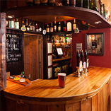 Full stave iroko worktops were chosen for this pub in Gloucestershire as they perfectly fit in with the rustic country pub interior.