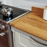 This full stave oak worktop has been given a beautiful customised edge which gives it a lovely traditional feel.
