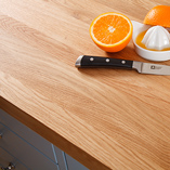 The natural characteristics of real wood worktops are beautifully showcased with full stave prime oak worktops.