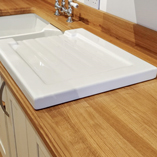 This full stave worktop features a Belfast sink as well as a removable drainer to make the most of the worktop space.