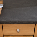 Grey slate laminate surfaces like this Luna Nero worktop are low maintenance, hardwearing and easy to clean.
