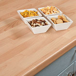 These beech block laminate worktops are a hard-wearing and low-maintenance choice for a variety of kitchen settings.