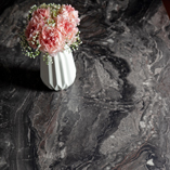 The intricate and unique design of this black laminate worktop emulates the natural pattern of authentic marble.