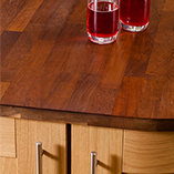 Iroko worktops are warm in colour and darken over time - perfect for a solid wood kitchen.