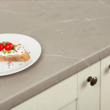 These laminate cream stone worktops feature an attractive stone effect