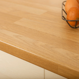 These laminate oak block worktops are textured to feel like solid oak.