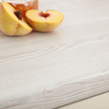 These white wood laminate worktops emulate the natural grain pattern of white pine.