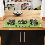 This large kitchen island combines solid oak worktops and other accents with very modern cabinet doors.