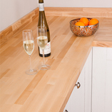 In a light kitchen setting, ash worktops can look as bright as maple, yet with a more distinctive linear grain.