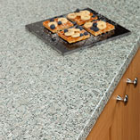 Laminate grey granite worktops have a lightly textured matt finish to enhance the stone effect.