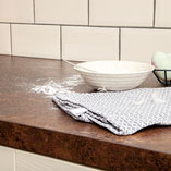 Low-maintenance, these copper effect worktops are a durable choice for any home