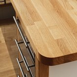 Fabricated bespoke oak worktops featuring rounded radius corners.