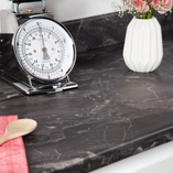 Both our Megara laminate worktops and matching upstands have been designed to resemble real black marble.