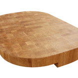 Oak end grain butchers block with radius corners and irregular cut out on the underside of the block.