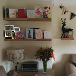 Elaine used our oak floating shelves to provide extra ornamental display space in her living room.