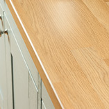 These affordable oak laminate worktops are made by wrapping a hard-wearing decorative veneer around a composite core.