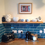 Ceri put up a set of our oak shelves to complement the worktops in her oak kitchen.