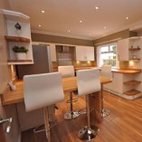 Oak worktops with solid oak breakfast bar.