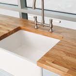 Consider our oak worktops for a classic kitchen setting alongside ceramic sinks and fixtures.