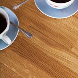 Oak worktops have a detailed yet familiar grain pattern that complements a number of kitchen styles.