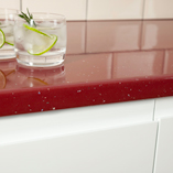 The post form edge on red sparkle worktops gives a beautiful stylish finish to these work surfaces.