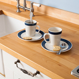 A Prime Beech worktop featuring a number of bespoke customisations including Belfast sink cut-out and drainage grooves.