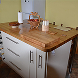 Prime Oak topped kitchen island with oak chopping board.