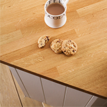 Prime Oak worktops feature staves of consistent colour and grain for kitchen continuity.