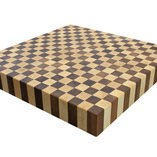 A rectangular maple and walnut end grain butchers block was cut down to a 680mm square.